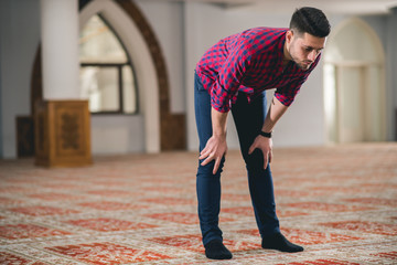 Muslim praying in bow position