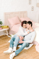 Couple in love sitting on the floor