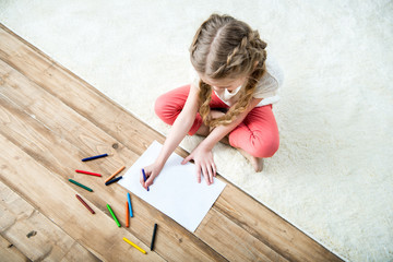 high angle view of little girl drawing picture