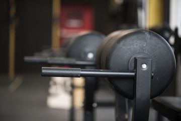 Closeup of gym equipment showing handles and pad with blurred background