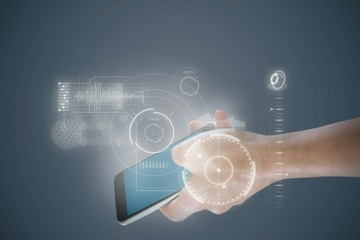 Composite image of close-up of hand holding mobile phone