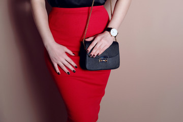 Wall Mural - Close up shapely woman wear elegant red skirt and black bag