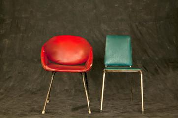 Vintage chairs on dark background