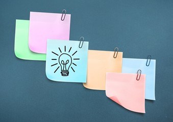 Composite image of colored Sticky Note Lightbulb Icon
