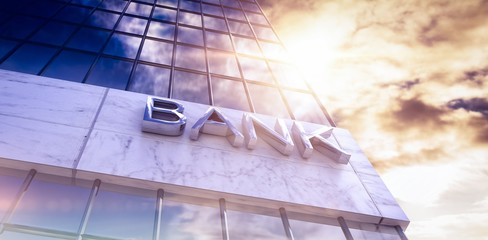 Composite image of low angle view of bank text building
