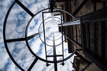 Staircase on a building to the clouds and sky