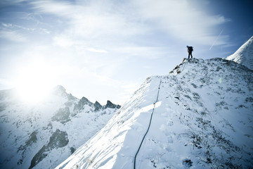 Man climbing to the snow peak of the Massif du Sancy