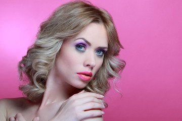 Beauty blonde model with blue eyes and great Make up