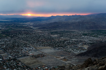 Early morning sunlight coming through the cloud cover over the desert city of Palm Springs