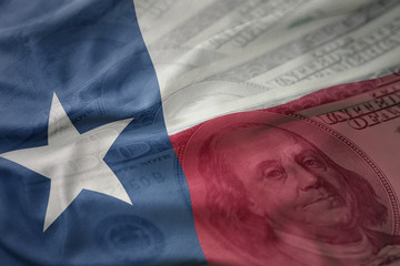 Autocollant pour porte Texas colorful waving flag of texas state on a american dollar money background. finance concept
