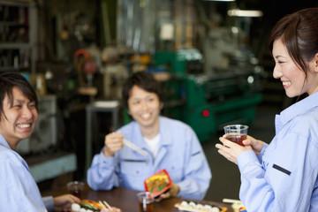 Three Factory Workers Having Lunch Break