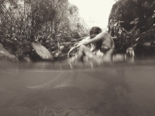 Water Surface Of Woman Sitting In River