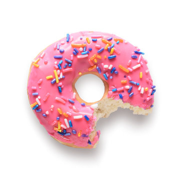Pink frosted donut with colorful sprinkles with bite missing. Isolated on white background and include clipping path