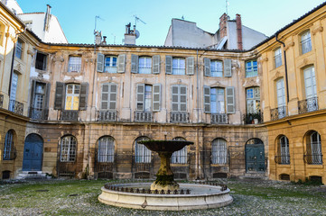 Romantic Fountain with Beautiful Old House in the Back at Place D'Albertas in Aix-en-Provence, France