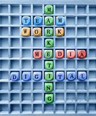 Words of business marketing concepts made with letters from a set of wooden cubes / concepts of communication digital marketing formed with wood cubes in the board