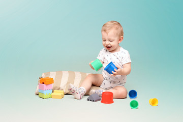 Adorable baby boy playing with some toys.