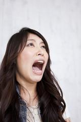 A young woman shouting