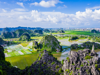 Panoramic view of karst formations and rice paddy fiels in Tam Coc, Ninh Binh province, Vietnam