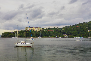 small sailing boat near the cost