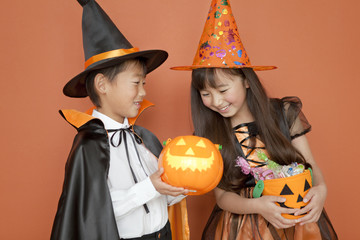 Boy and girl dressed for halloween