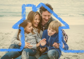 Happy family enjoying on beach above outline house