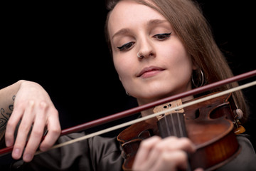 violinist woman with a nose piercing playing