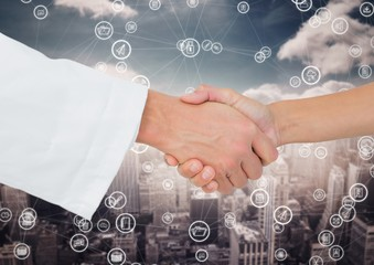 Close-up of businessman and woman shaking hands with each other