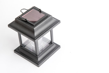 Garden lantern on solar panels in black, photographed on a white background in the studio. Vintage