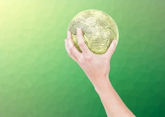 Hand of athlete holding ball against textured green background
