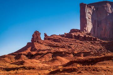 Unique natural monuments created by erosion in Monument Valley.