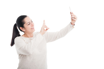 Cheerful lady taking a selfie