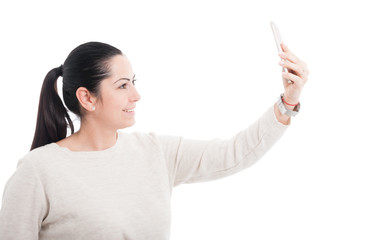 Beautiful female taking a  self portrait with cellphone