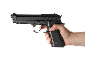 Man's hand holding gun on white background