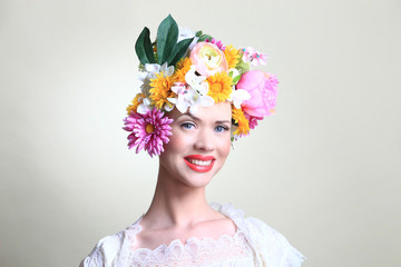 Smiling Spring with great beauty model and flowers.