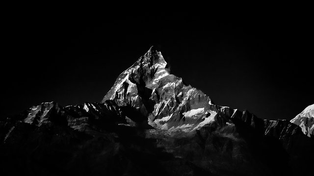 Machapuchare mountain peak in Himalaya. Black and white color.