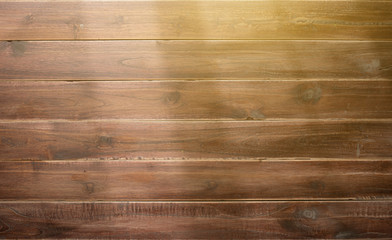 Wooden background with shadows from a window frame,morning light