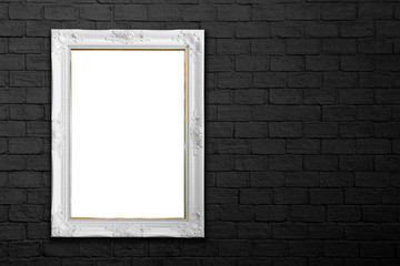 white frame on black brick wall