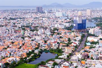 Vung Tau, Vietnam - January 18, 2017: Birds eye view of Vung Tau city from statue of Jesus on Tao Phung mountain, Vung Tau beach city, SoundVietnam.