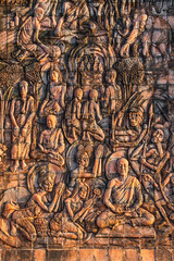 Art on the stone about buddha story on temple wall