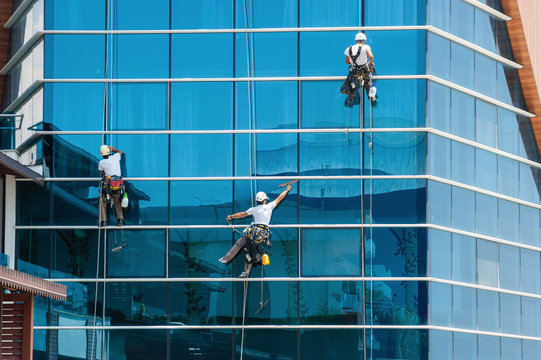 workers washing windows of the modern building