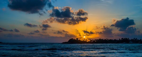Panoramic view of a beautiful tropical beach In Unawatuna, Sri Lanka, at sunset. Sri Lanka is a popular destination For A Beach Holiday.