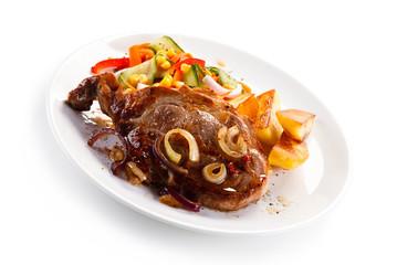 Roast steak with baked potatoes