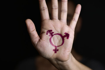 transgender symbol in the palm of the hand