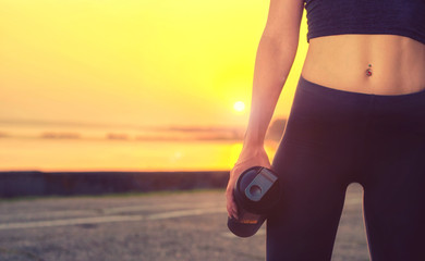 Close up portrait of a sports girl  holding a shaker with protein