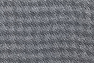 Dark gray fluffy background of soft, fleecy cloth. Texture of textile closeup