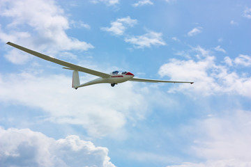 Glider flying under a blue sky