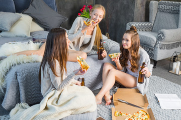 Female friends eating pizza