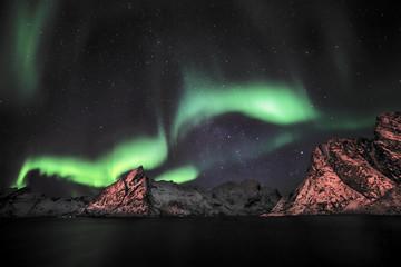 Aurora borealis (Polar lights) over the mountains in the North of Europe - Reine, Lofoten islands, Norway
