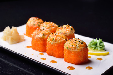 baked rolls, traditional Japanese cuisine. dark background