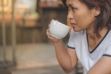Woman drink coffee.